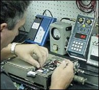 Bench Tech Working On Electronic Repair